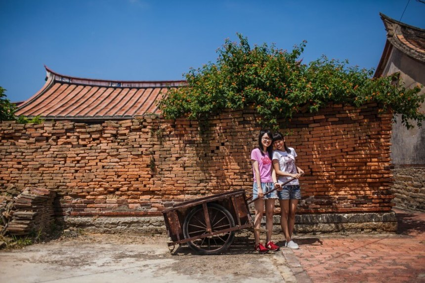 Posing for a photo in Beishan Village