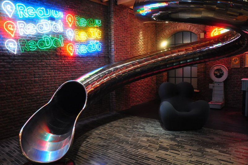 the-slide-at-the-lobby-of-red-dot-hotel